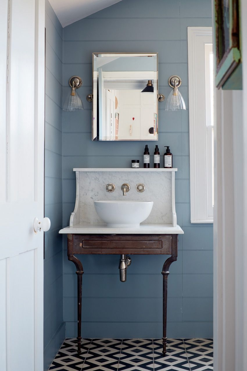 Blue Shiplap Bathroom With Black And White Tiled Floor And Antique Vanity  Bathroom Design